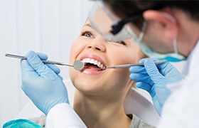 Dentist performing dental checkup to prevent dental emergencies