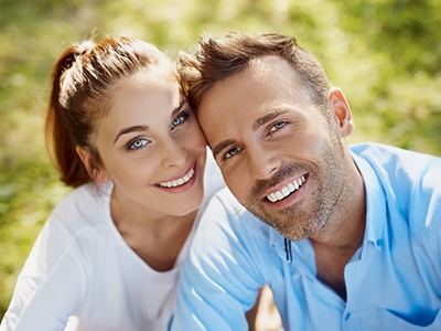 Man and woman smiling after preventive dentistry