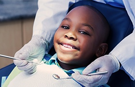 Young boy smiling during children's dentistry visit