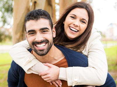 Man and woman with healthy smiles thanks to advanced dental services and technology
